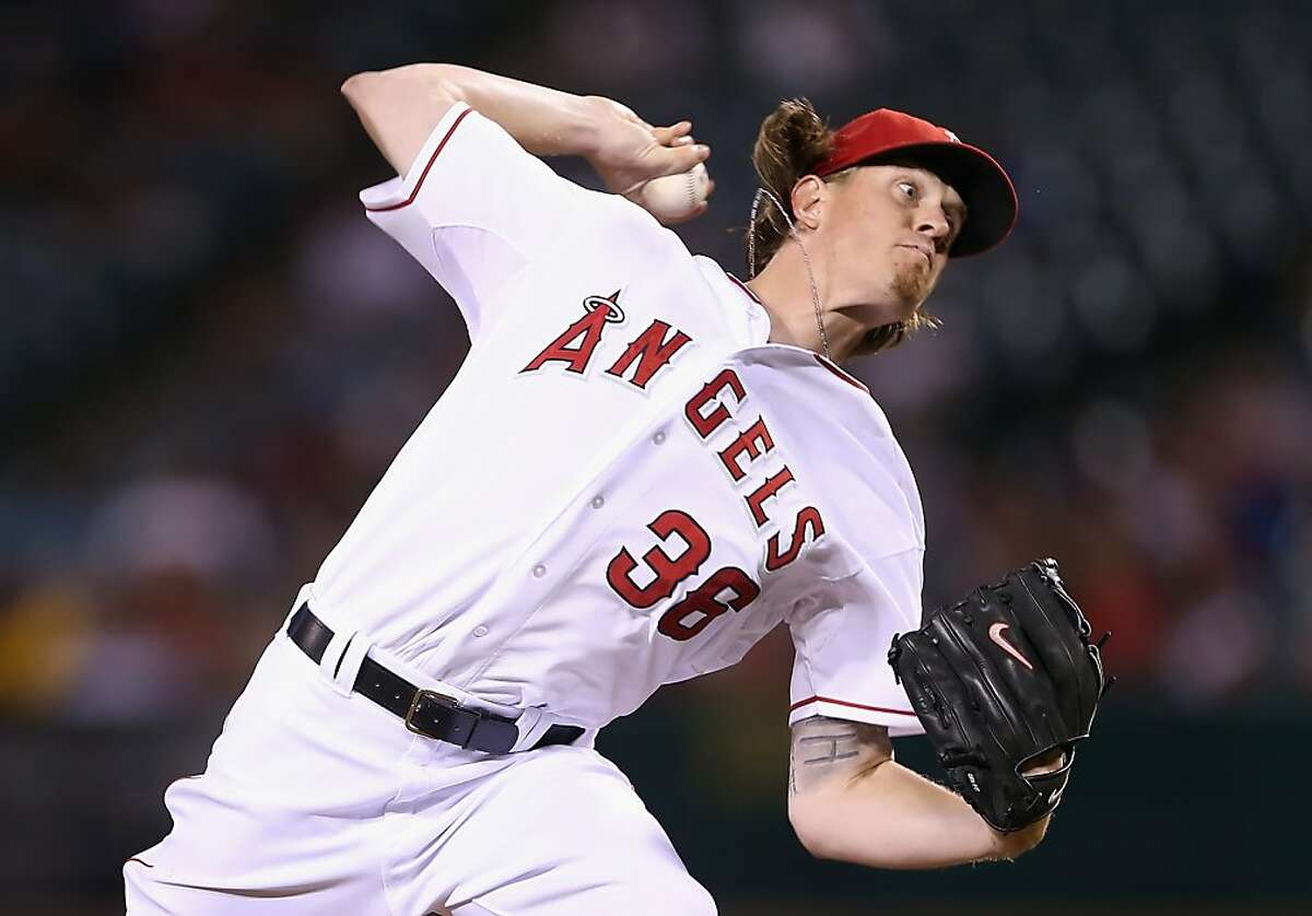 ANAHEIM, CA - SEPTEMBER 18: Jered Weaver #36 of the Los Angeles Angels of Anaheim pitches against the Texas Rangers in the seventh inning at Angel Stadium of Anaheim on September 18, 2012 in Anaheim, California. The Angels defeated the Rangers 11-3. (Photo by Jeff Gross/Getty Images)