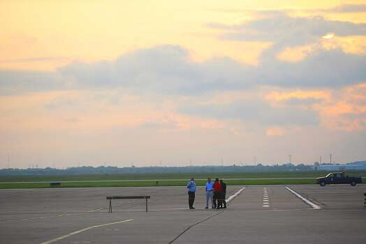 People wait for the arrival of the Space Shuttle Endeavour at Ellington field. Photo: Nick De La Torre, Houston Chronicle