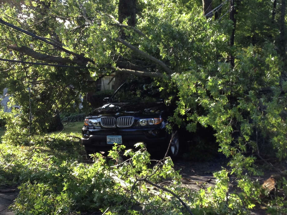 A storm the night of Tuesday, Sept. 18, 2012 brought part of a tree down on this sport utility vehicle on Greenfield Road in Stamford, Conn. Photo: John Nickerson