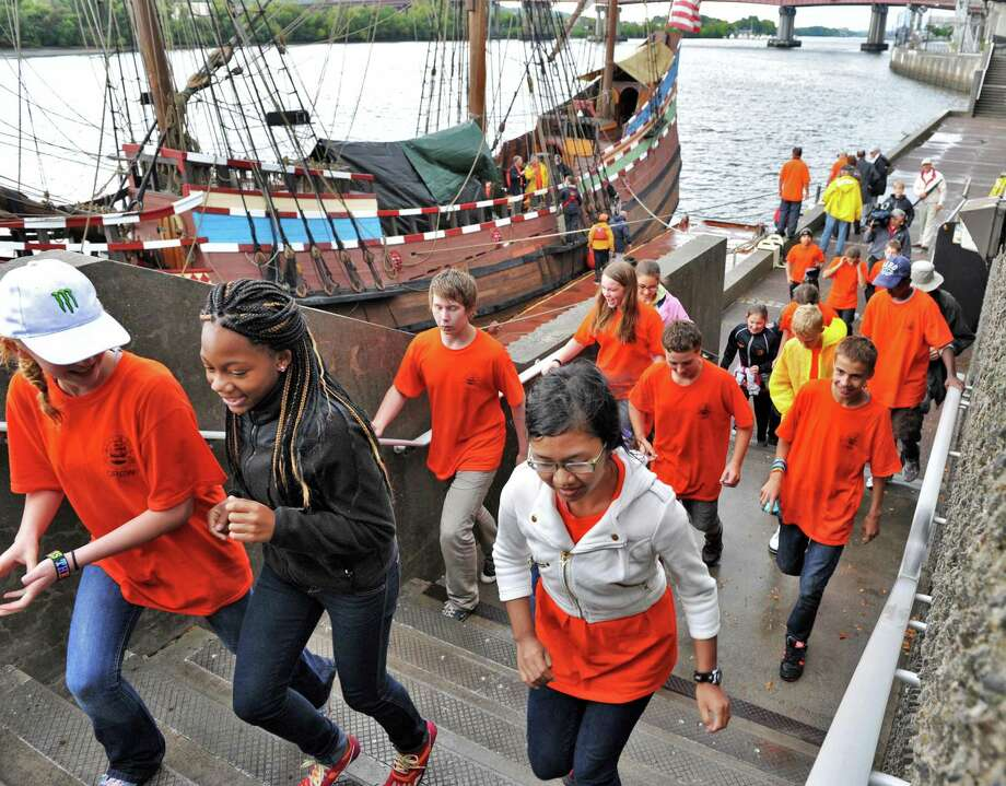 Dutch and American middle school students disembark the replica 17th century sailing ship Half Moon at Albany's Corning Preserve Tuesday Sept. 18, 2012, after they re-created the original voyage of Henry Hudson from September 1609.  (John Carl D'Annibale / Times Union) Photo: John Carl D'Annibale / 00019224A