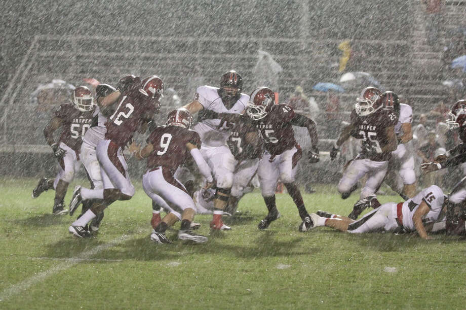 The rain came down hard early in the second quarter. Photo: Jason Dunn