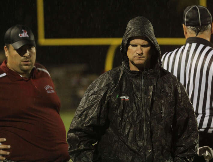 Darrell Barbay dons his rain gear for last Friday's contest.