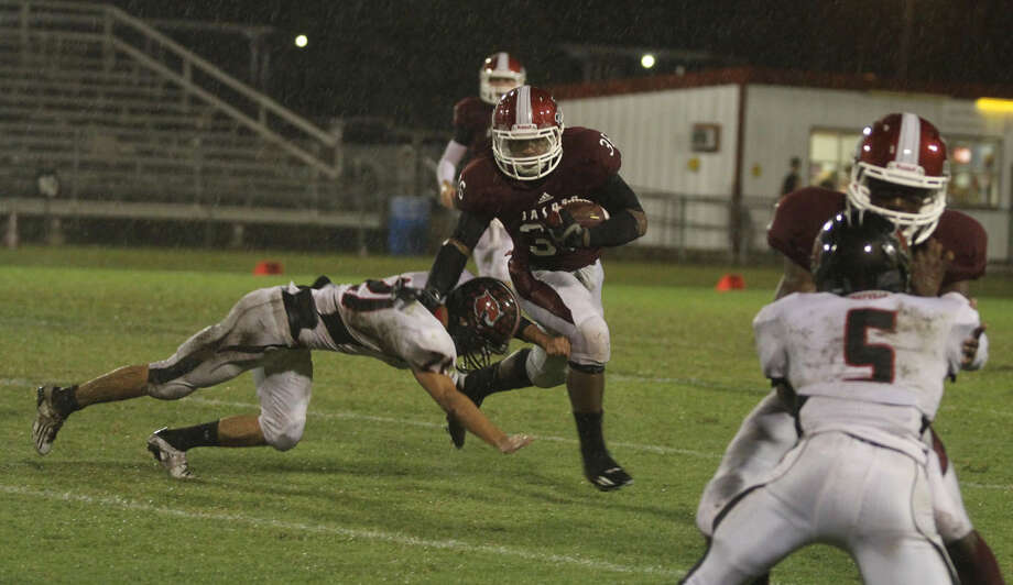 Terrance Cuney follows his blocker for a large gain. Photo: Jason Dunn