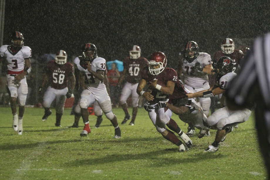 Donovan Middleton tries to break free from Kirbyville defenders. Photo: Jason Dunn