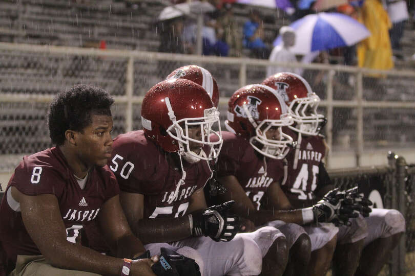 While fans huddled under umbrellas, Jasper's players dealt with the rain conditions on their own.