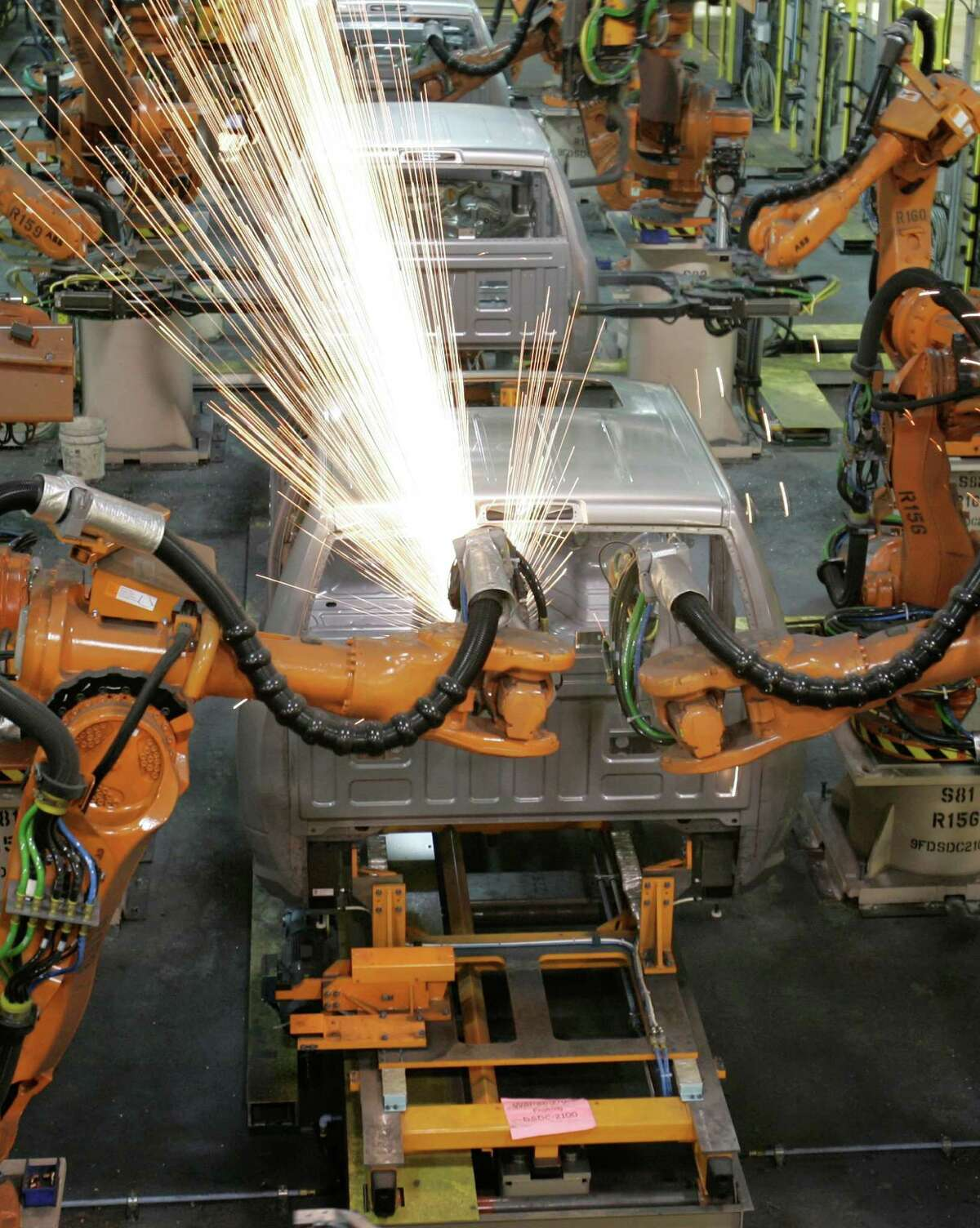 Robots weld a truck cab at a Chrysler plant in Michigan. As new generations of super