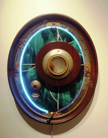 "Austin artist Steve Brudniak's ""Vunderglas"" features neon and spinning mirrors. Photo: Steve  Bennett, San Antonio Express-News"