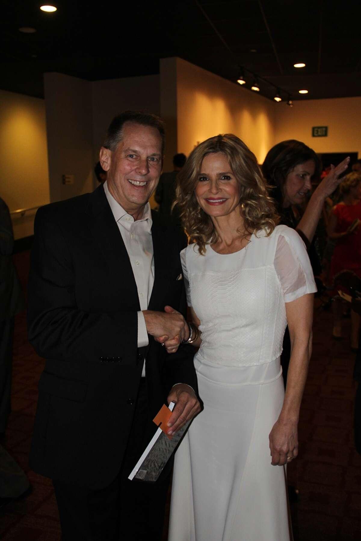 Jason Haxton meets actress Kyra Sedgwick at the premiere of