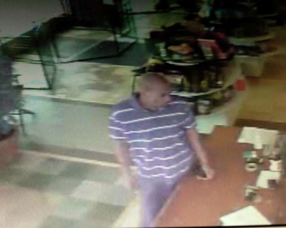 Surveillance video of a man suspected of running off with stolen English bulldog vauled at $3,700 from a Norwalk pet store. Photo: Contributed Photo