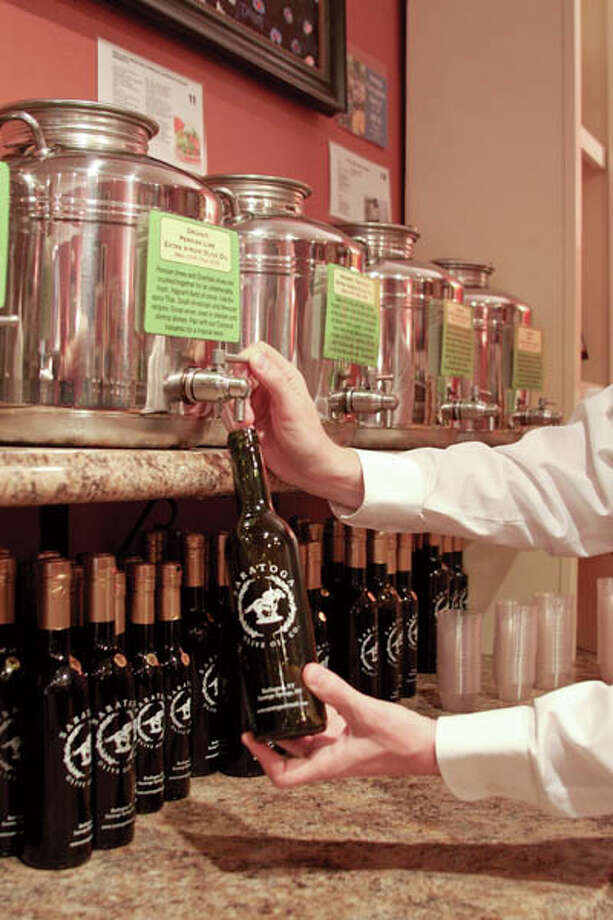 Family-run Saratoga Olive Oil encourages customers to taste their many 