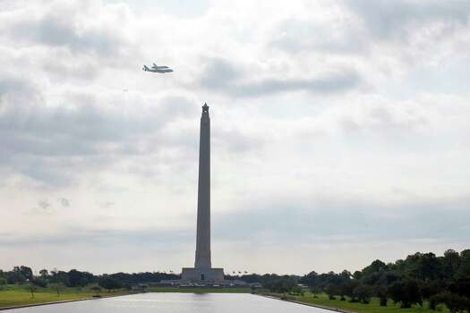 The space shuttle Endeavour rides atop a NASA 747 Shuttle Carrier Aircraft as it passes over the San Jacinto Monument Wednesday, Sept. 19, 2012, in La Porte. The shuttle is being ferried across the United States from the Kennedy Space Center to the California Science Center in Los Angeles. Photo: James Nielsen, Chronicle / © Houston Chronicle 2012