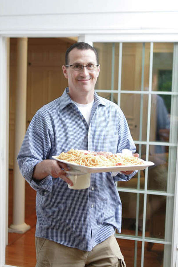 Paul Valente, a member of the family that owns Valente's Restaurant in Watervliet, lives in a spacious Loudonville home where he developed his recipes for award-winning mac-n-cheese. It's now produced commercially and available at local grocery stores. Read the story  here; get Chef Valente's  recipes here . Photo: Suzanne Kawola/Life@Home