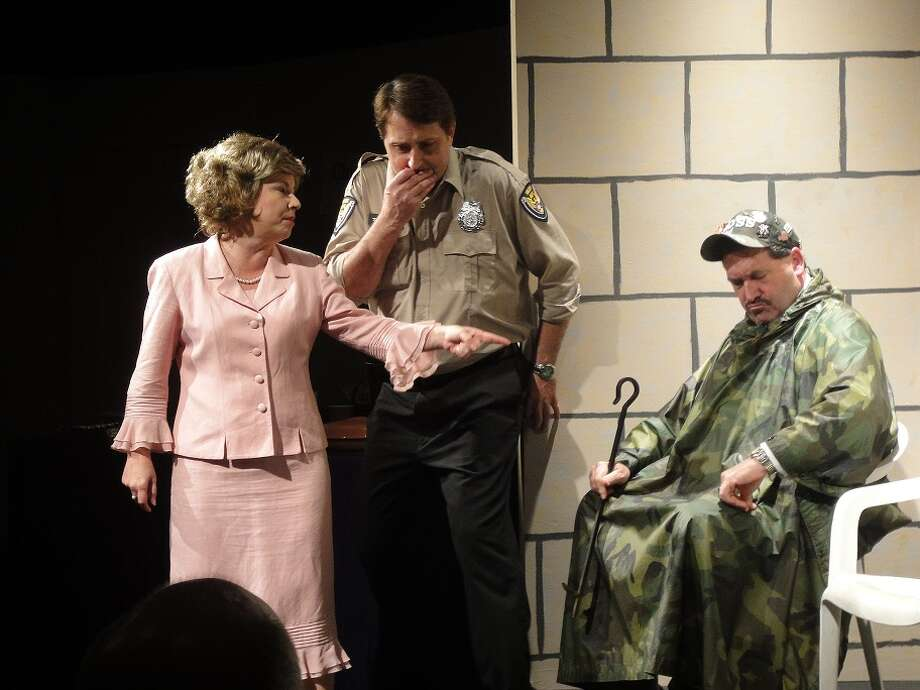 "Frankie (Dana Williams) confronts her husband (Ted S. Gibbs, right) and his buddy (Dustin Lucas, center) about the pig roasting on the church grounds in ""Dearly Beloved.""  Photo: Courtesy, Christine Crowley"