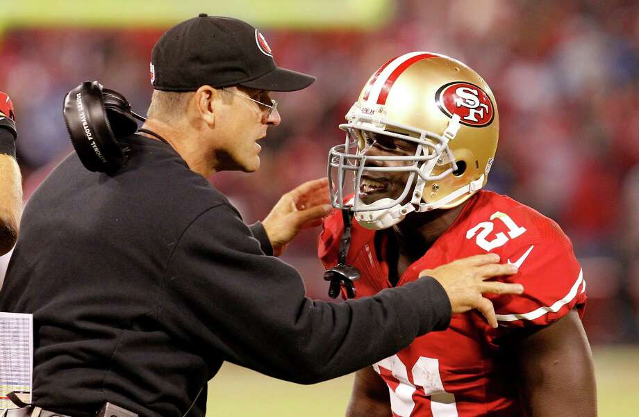 Jim Harbaugh talked with Frank Gore near the end of the game. The San Francisco 49ers defeated the Detroit Lions 27-19 at Candlestick Park Sunday September 16, 2012. Photo: Brant Ward, The Chronicle / ONLINE_YES