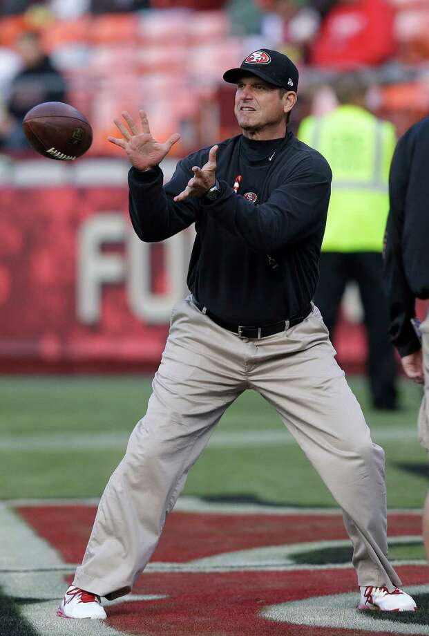 San Francisco 49ers head coach Jim Harbaugh catches a ball before an NFL preseason football game against the San Diego Chargers in San Francisco, Thursday, Aug. 30, 2012. Photo: Marcio Jose Sanchez, Associated Press / AP