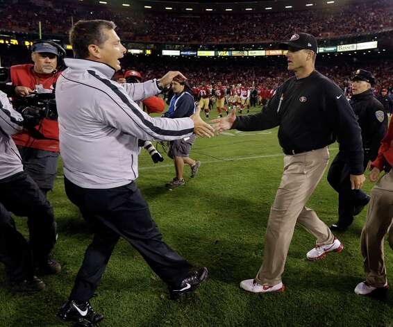 Detroit Lions head coach Jim Schwartz, left, shakes hands with San Francisco 49ers head coach Jim Harbaugh at the end of an NFL football game in San Francisco, Sunday, Sept. 16, 2012. San Francisco won 27-19. Photo: Marcio Jose Sanchez, Associated Press / AP