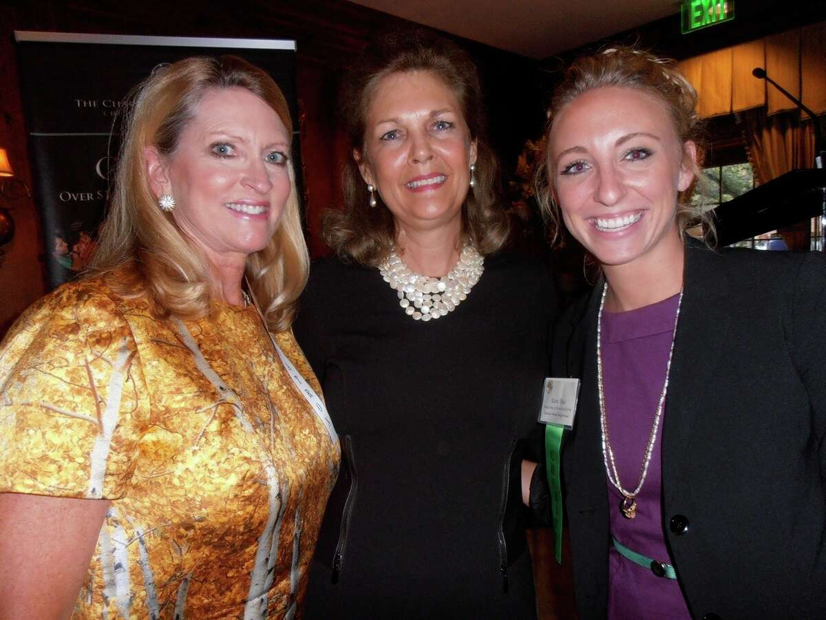 Charity Ball Association member Michele Cadwallader, from left, President Heather Wolff and Katie Pace of the United Way of San Antonio gather for the announcement of association grants for 2012.