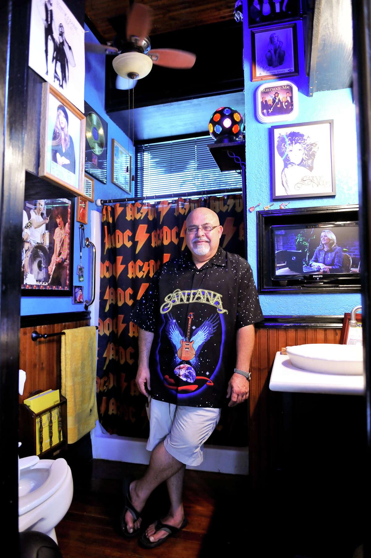 Al Lomas is proud of his rock-memorabilia-filled bathroom.