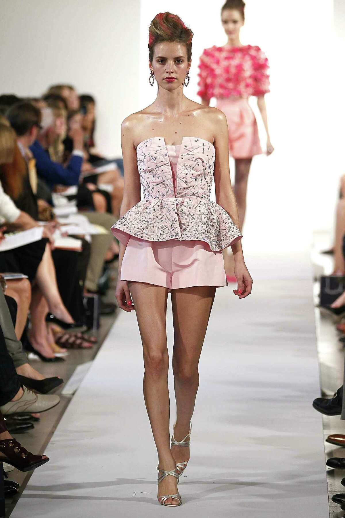 Oscar de la Renta offers flared cocktail shorts with a corset top.