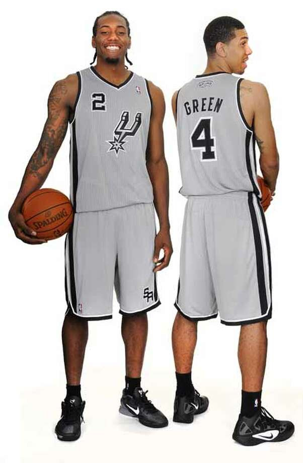 The San Antonio Spurs unveiled today a new alternate jersey that will be worn during the upcoming 2012-13 NBA season. Kawhi Leonard and Danny Green are shown wearing the uniform. The fresh look silver jerseys with black trim feature the Spurs iconic secondary logo prominently on the front.  The alternate jerseys will debut at the home opener vs. the Oklahoma City Thunder on Nov. 1 and be worn during multiple home games throughout the season. (ALL RIGHTS RESV'D) Photo: BOB HOWEN 2009 / ALL RIGHTS RESV'D