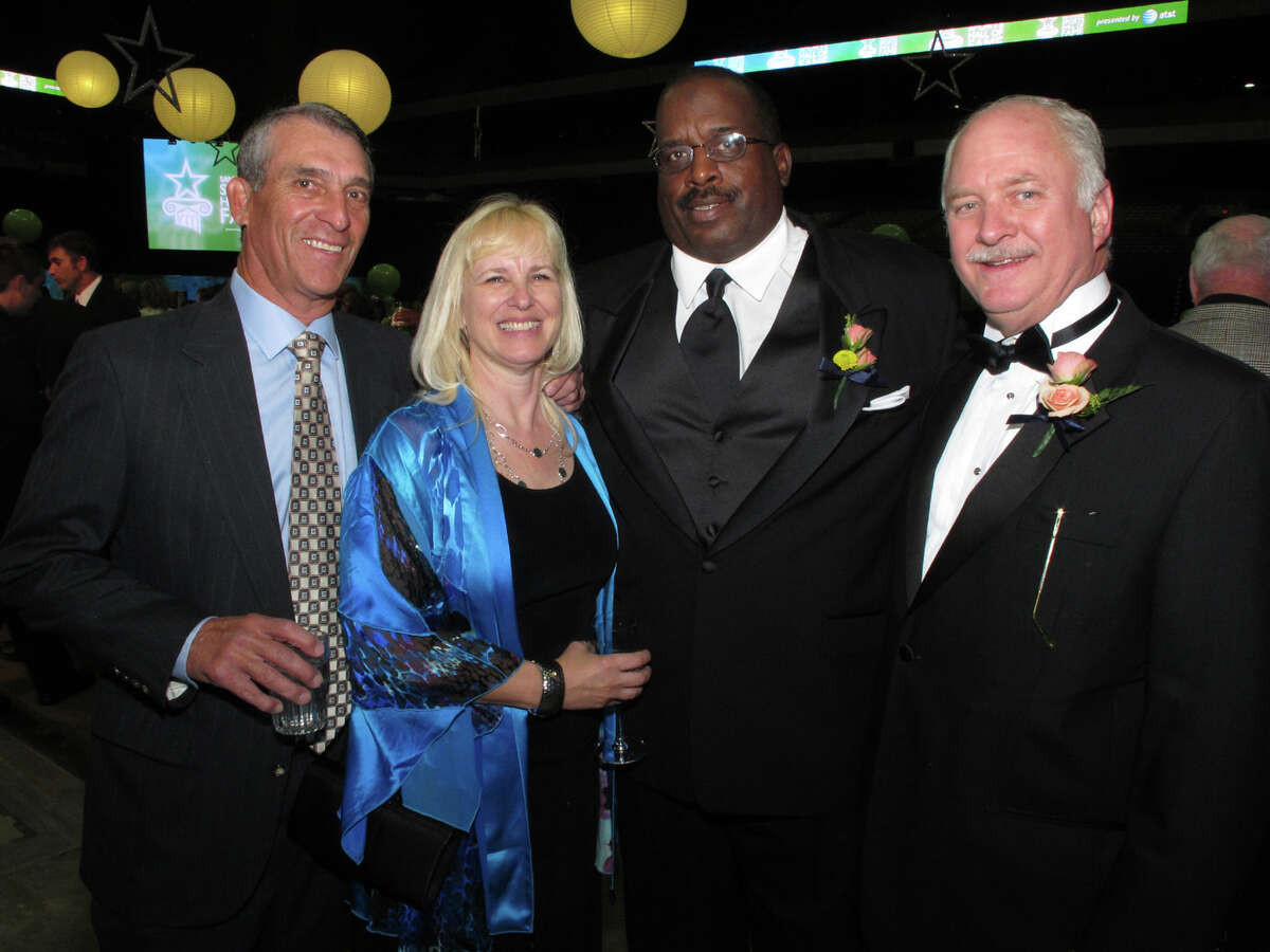 Guests Gary White, from left, Ann Hill, inductee and spouse to Ann, David Hill and San Antonio Sports Foundation chairman George Block gather at the San Antonio Sports Hall of Fame Tribute at the Alamodome on 2/10/2012. This is #1 of 2 photos. names checked photo by leland a. outz