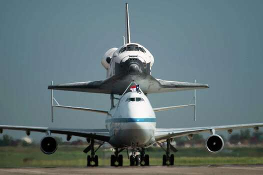 The space shuttle Endeavour, carried atop NASA's 747 Shuttle Carrier Aircraft, arrives at Ellington Field on Wednesday, Sept. 19, 2012, in Houston. Endeavour stopped in Houston on its way from the Kennedy Space Center to the California Science Center in Los Angeles, where it will be placed on permanent display. Photo: Smiley N. Pool, Houston Chronicle / © 2012  Houston Chronicle