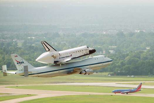 The space shuttle Endeavour, carried atop NASA's 747 Shuttle Carrier Aircraft, makes a low altitude pass over Hobby Airport during a flyover on Wednesday, Sept. 19, 2012, in Houston. Endeavour stopped in Houston on its way from the Kennedy Space Center to the California Science Center in Los Angeles, where it will be placed on permanent display. Photo: Smiley N. Pool, Houston Chronicle / © 2012  Houston Chronicle