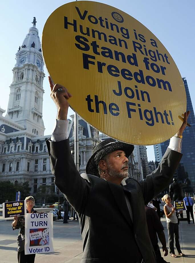 Jay Kohn displays his displeasure with Pennsylvania's new voter ID law at an NAACP rally in Philadelphia earlier this month. The law was sent back to a lower court to review this week whether voters would be disenfranchised. Photo: Michael Perez, Associated Press