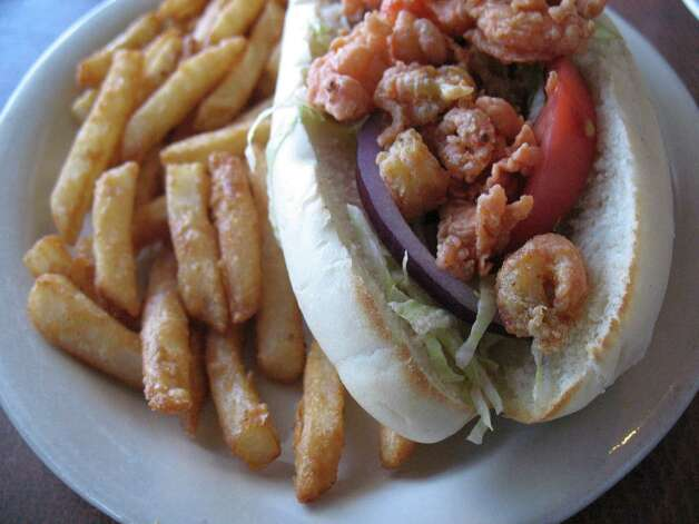 The shrimp po'boy at Texas Seafood Grill comes with hard-to-resist battered french fries. Photo: Jennifer McInnis, San Antonio Express-News