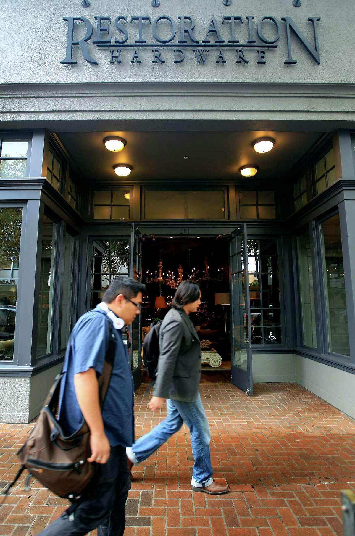 Pedestrians pass a Restoration Hardware Inc. store in Palo Alto, California, California, U.S., on Tuesday, Oct. 11, 2011.