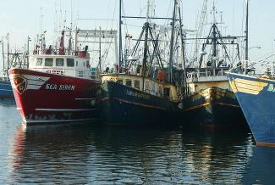 FILE - This April 30, 2004 file photograph shows fishing boats docked at the pier in New Bedford, Mass. The U.S. seafood catch reached a 17-year high in 2011, with all fishing regions of the country showing increases in both the volume and value of their harvests. New Bedford, Mass., had the highest-valued catch for the 12th straight year, due largely to its scallop fishery.