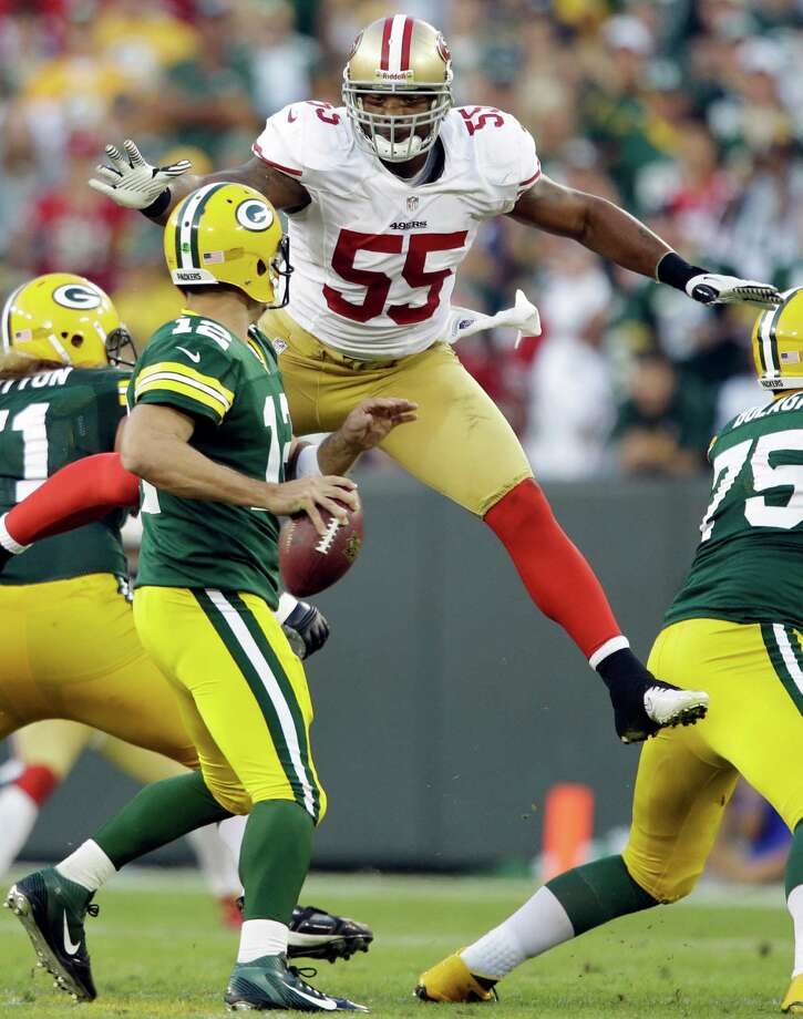 Ahmad Brooks leaps up to sack Green Bay Packers quarterback Aaron Rodgers during the second half of an NFL football game Monday, Sept. 10, 2012, in Green Bay, Wis. The 49ers won 30-22. Photo: Jeffrey Phelps, Associated Press / FR59249 AP