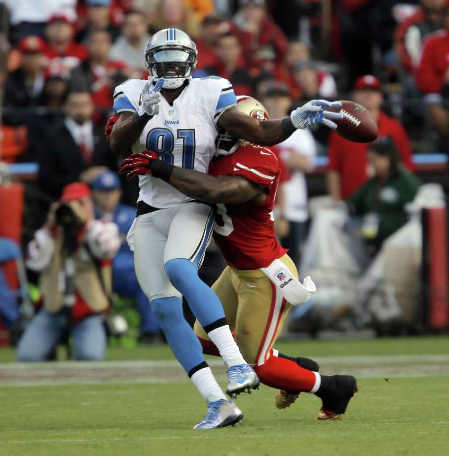 Calvin Johnson can't keep his hands on ball thrown by Matthew Stafford as it is broken up by NaVorro Bowman in the third quarter. The San Francisco 49ers played the Detroit Lions at Candlestick Park in San Francisco, Calif., on Sunday, September 16, 2012. Photo: Carlos Avila Gonzalez, The Chronicle / ONLINE_YES