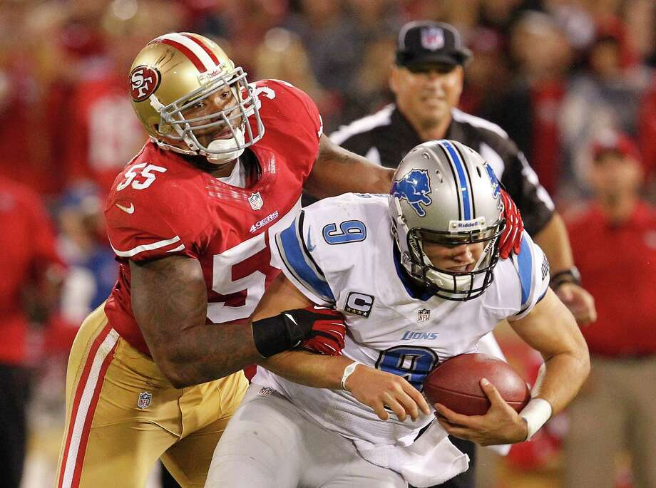 Detroit Lions quarterback Matthew Stafford, right, is brought down by San Francisco 49ers outside linebacker Ahmad Brooks, left, during the fourth quarter of an NFL football game in San Francisco, Sunday, Sept. 16, 2012. Photo: Tony Avelar, Associated Press / AP