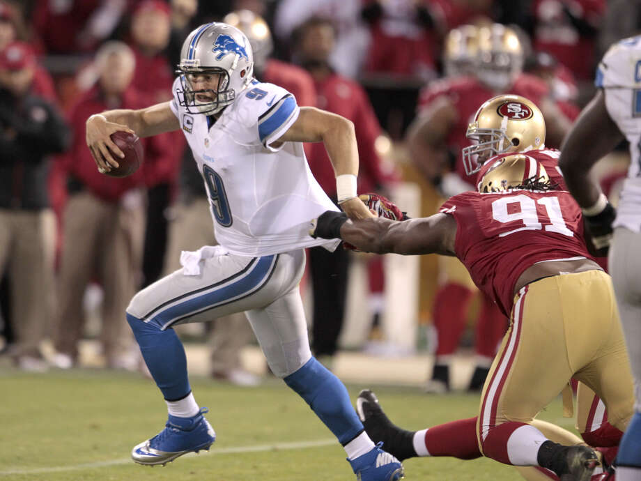 Detroit Lions quarterback Matthew Stafford gets taken down by 49ers Linebacker Ray McDonald (91) and Ahmad Brooks during their game at Candlestick Park in San Francisco, Calif., on Sunday September 16, 2012. Photo: John Storey, Special To The Chronicle / ONLINE_YES