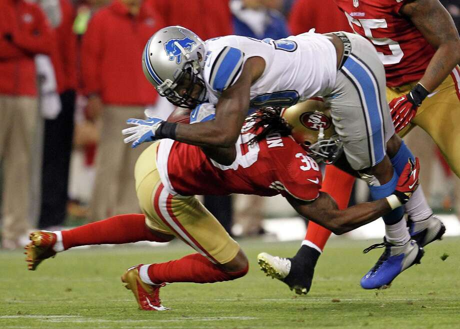 Detroit Lions running back Kevin Smith, top,  is upended by San Francisco 49ers free safety Dashon Goldson, bottom, during the third quarter of an NFL football game in San Francisco, Sunday, Sept. 16, 2012. Photo: Tony Avelar, Associated Press / AP