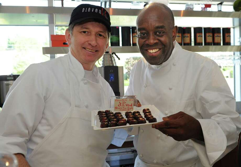 Francois Kwaku-Dongo, executive chef, left, and Didier Berlior, pastry chef, at the eleven14 Kitchen at the J Hotel in Greenwich at the new Chocolate Lab Wednesday, Sept. 19, 2012. Photo: Helen Neafsey / Greenwich Time