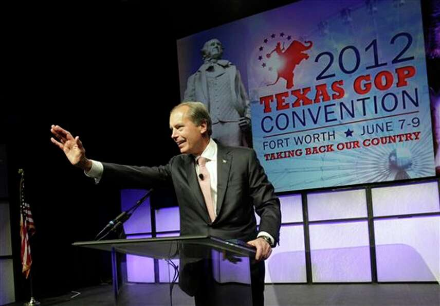 David Dewhurst waves before speaking during  the Texas Republican Convention in Fort Worth, Texas,