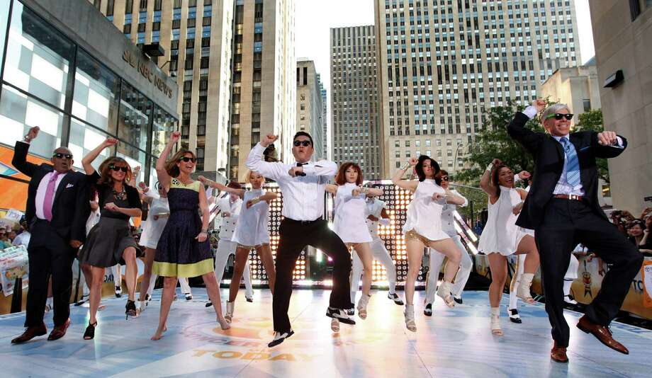 "South Korean rapper Psy, center, is joined by hosts, from left, Al Roker,  Natalie Morales, Savannah Guthrie and David Gregory as he performs his massive K-pop hit ""Gangnam Style"" live on NBC's ""Today"" show, Friday, Sept. 14, 2012, in New York. (Photo by Jason DeCrow/Invision/AP Images) Photo: Jason DeCrow, Associated Press / Invision"