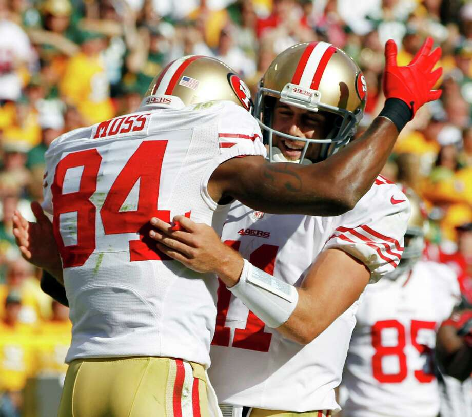 San Francisco 49ers' Randy Moss is congratulated by quarterback Alex Smith after Moss caught a touchdown pass during the first half of an NFL football game against the Green Bay Packers Sunday, Sept. 9, 2012, in Green Bay, Wis. Photo: Mike Roemer, Associated Press / FR155603 AP