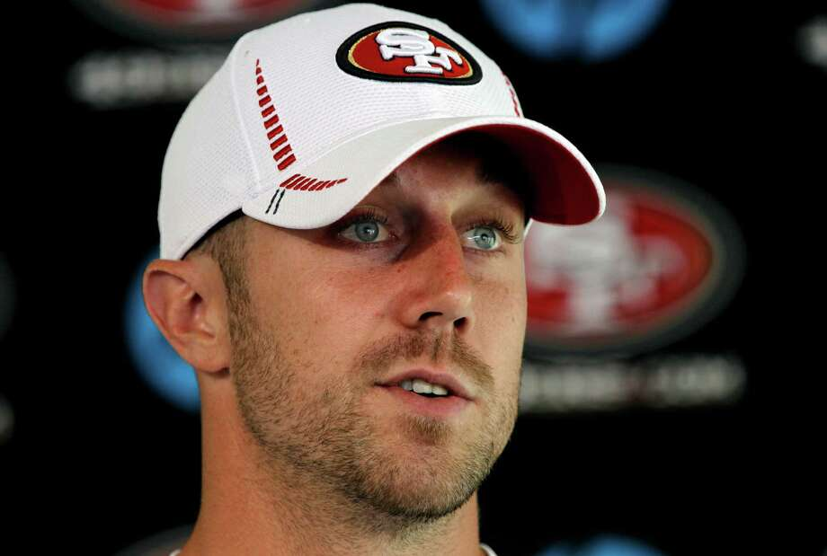 49ers' quarterback Alex Smith, speaks to the media during a press conference, as the San Francisco 49ers hold training camp on Friday July 27, 2012, in Santa Clara, Calif. Photo: Michael Macor, The Chronicle / ONLINE_YES