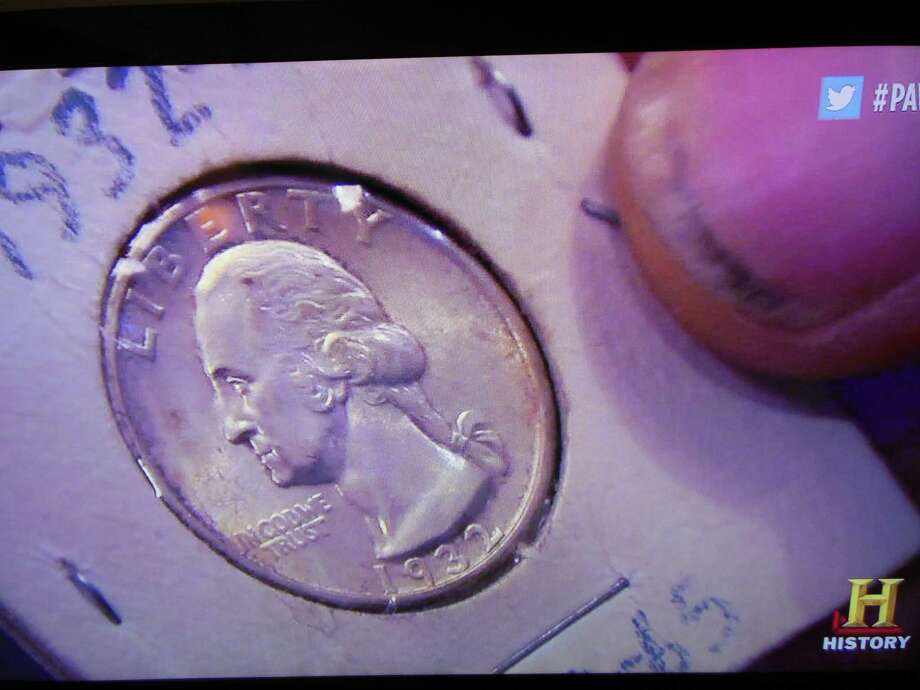 "A screen shot from the History Channel's ""Pawn Stars"" shows an 1932 quarter and Rick Harrison's dirty thumbnail. Photo: Ken Hoffman"