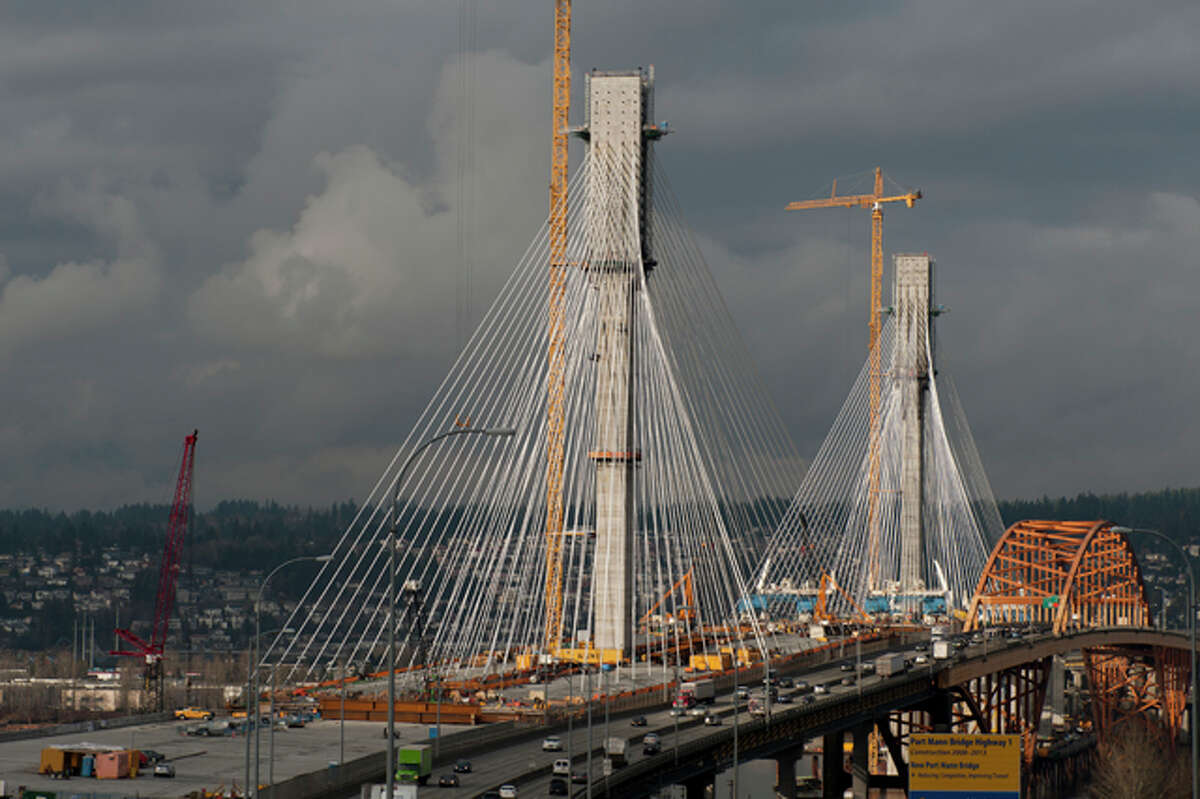 The new Port Mann Bridge, in British Columbia, just officially became the world's widest bridge, at 213 feet. The bridge crosses the Fraser River, connecting Coquitlam to Surrey, near Vancouver. That got us thinking about other record bridges. Click on to see what we found, including where Washington fits in.