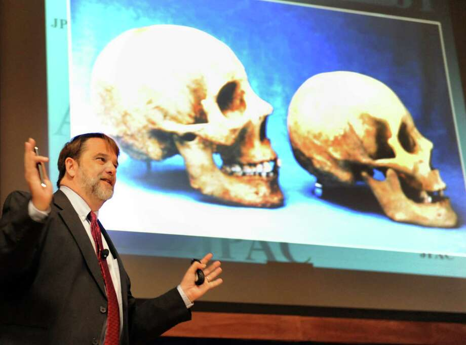 Forensic anthropologist Tom Holland, scientific director of the Central Identification Laboratory for the Joint POW-MIA Accounting Command, speaks Wednesday, Sept. 19, 2012, at the New York State Police Academy in Albany, N.Y. (Cindy Schultz / Times Union) Photo: Cindy Schultz /  00019333A
