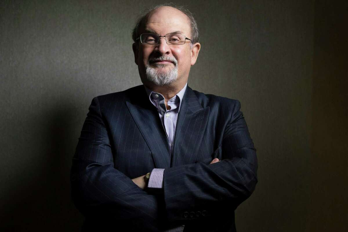 FILE - This Sept. 8, 2012 file photo shows author Salman Rushdie posing for a photo as he promotes the movie