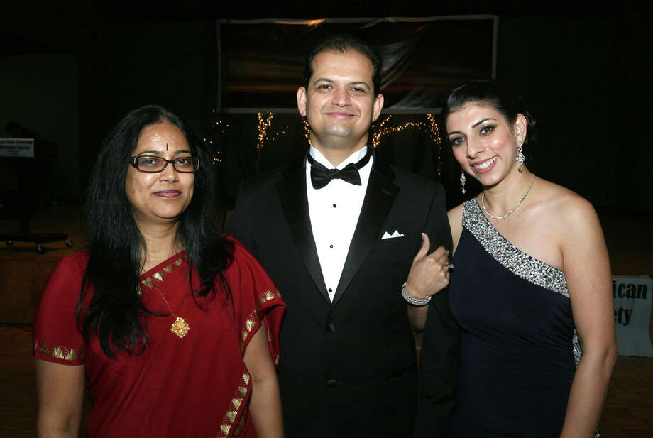 OTS/HEIDBRINK - President Neela K. Patel MD, from left, chairman Hormazd Sanjana MD and spouse and event emcee Shernaz Sanjana gather at the Indo-American Physicians gala at Holy Trinity Banquet Hall on 9/15/2012. names checked photo by leland a. outz Photo: LELAND A. OUTZ, SPECIAL TO THE EXPRESS-NEWS / SAN ANTONIO EXPRESS-NEWS
