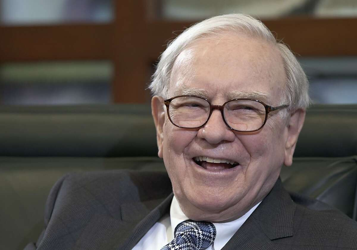 FILE - In this May 7, 2012, file photo Warren Buffett, chairman and CEO of Berkshire Hathaway, laughs during an interview in Omaha, Neb. Omaha won't throw a bash for Buffett's 82nd birthday on Thursday, Aug. 30, 2012, but his hometown is grateful the billionaire never considered leaving Omaha behind because he has bolstered the city's reputation and attracted thousands of tourists. (AP Photo/Nati Harnik, File)