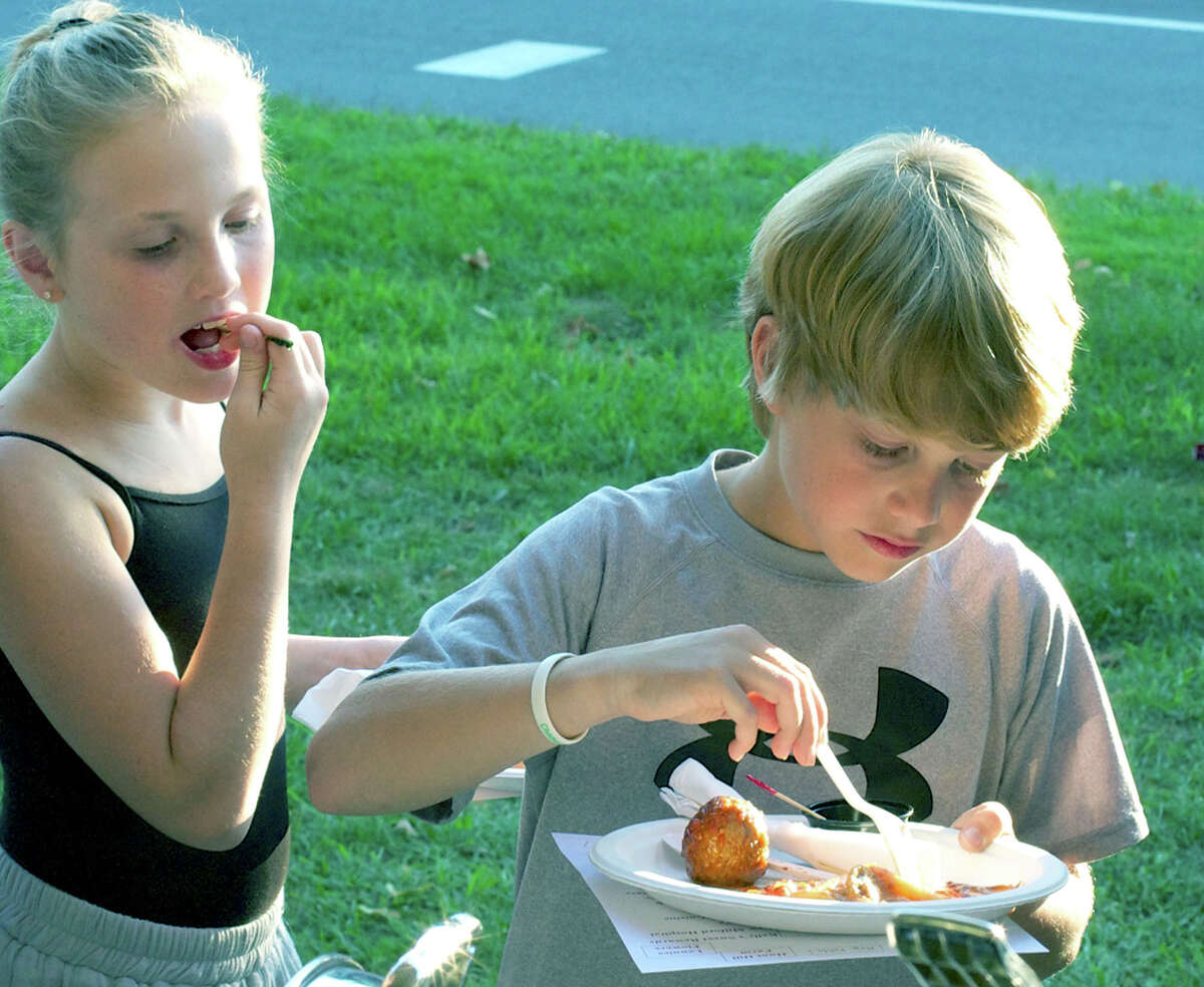 Abby Grace Omana, 9, and her brother, Brendan, 11, each feast on a meatball and ziti from Lucia Ristorante during Taste of New Milford. Sept. 12, 2012 Lucia Ristorante, New Milford Litchfield County Ballo, Mohegan Sun, Uncasville New London County