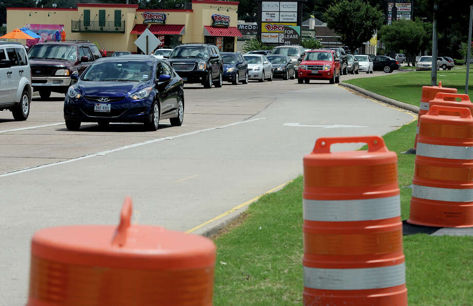 Construction barrels line Dowlen Road near Phelan Boulevard in July. Construction like this could soon be seen on Dowlen from Eastex Freeway to Delaware. The city of Beaumont would like to spend $800,000 to widen the roadway from four to six lanes.  Guiseppe Barranco/The Enterprise Photo: Guiseppe Barranco, STAFF PHOTOGRAPHER / The Beaumont Enterprise