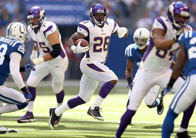 INDIANAPOLIS, IN - SEPTEMBER 16:  Adrian Peterson #28 of the Minnesota Vikings runs with the ball during the NFL game against the Indianapolis Colts at Lucas Oil Stadium on September 16, 2012 in Indianapolis, Indiana.  (Photo by Andy Lyons/Getty Images) Photo: Andy Lyons, Getty Images